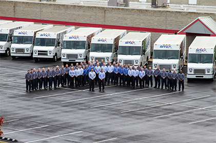 group photo of SITEX crew and trucks